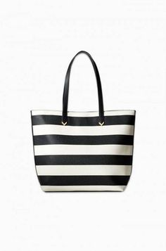 Tote around in style with this bag all year long. Wipeable, textured material. Genuine leather handles.
