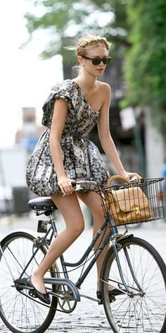 love this girl on her bike with a fabulous side braid!