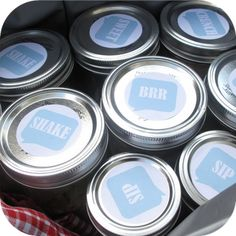 """Pretty much the cutest way to pack a mason jar lunch or picnic. Jars of food with labels on top showing what kind of nom noms you are about to enjoy (my favorite is """"BRR"""" -- the jar packed with ice to keep everything cool!)."""