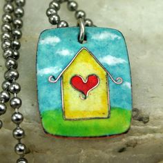 Lovely little house built of of fine copper wire with a heart details.  Enameled Piece width: 1 x 3/4  Chain Length: 18    Enameling is fusing glass