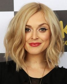 medium hair length- blonde, wavy, thick and a diamond shaped face