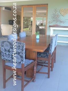 Our six-seater Mahogany table and upholstered chairs