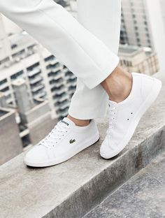 A pair of white Lacoste sneakers, because fashion week is coming up and you need to get your street-style looks down