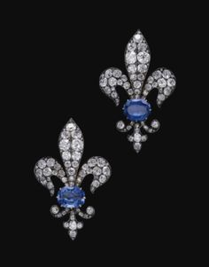 A late-nineteenth-century pair of sapphire and diamond brooches in the form of fleurs-de-lys, symbolic of France. (Sotheby's)