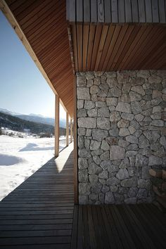The Alpine Hut Emphasizes Slovenia Thanks to OFIS arhitekti& updated modern reinterpretation of a mountain cabin. Check it out! Architecture Details, Interior Architecture, Alpine House, Moderne Pools, Stone Cladding, Exterior Stone Wall Cladding, Facade House, Wooden Columns, House Design