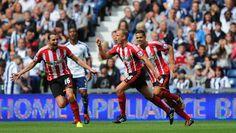 Sunderland player Lee Cattermole celebrates after scoring the opening...
