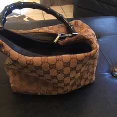 Gucci Bamboo handbag Used. Condition:  Very worn,  canvas is frayed in some spots on the bottom edges of the bag (shown in photo). Color: Taupe/Black Gucci Bags Totes