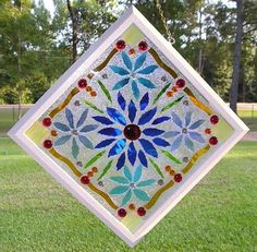 Make a faux stained glass window with common craft supplies