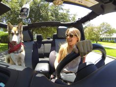 A girl and her dog, and her jeep.