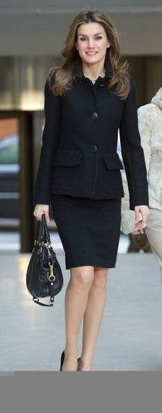 Black 3-button high collar skirt suit, black and white silk blouse