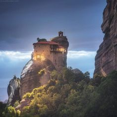 When the night falls on Meteora land, it becomes even more magical. Monasteries change to fairy tale castles in the sky, almost like from a Miyazaki scenes.  No tourists around, just distant sounds of the village and birds murmuring in leaves ready to sleep... Danielkordan.com Greece vacation  #Greece #Meteora