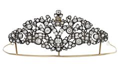 DIAMOND TIARA, LATE 18TH CENTURY  Of scroll and foliate design highlighted with cushion and circular-cut diamonds, mounted in silver and gold,