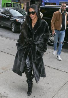 Kim and North match in chic all-black looks while lunching in NYC #dailymail