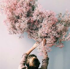 The latest wedding trend is nebulous airy and levitational designs and we are OBSESSED Dried branches and florals kokedama botanical inspo and frozen in time design inspi.