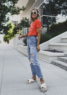Red t-shirt + high-waisted distressed jeans + white platform sandals