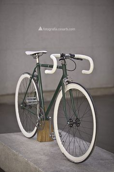 Nice fixed gear bicycle with wooden stand