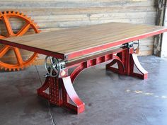 "Bronx table with reclaimed boxcar oak top - Our flagship Bronx Crank Table features two massive 5-ton screw mechanisms and two 12"" crank wheels that adjust the top from 30"" dining height to 42"" bar height."