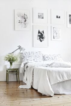 white frames configured above a bed