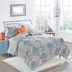 Brighten your master suite or guest room with this stylish comforter set, showcasing a boho-chic medallion motif that reverses to a ditsy floral design....
