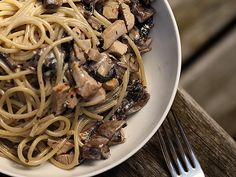 spaghetti in cream sauce with portabella mushrooms, chicken, rosemary and lemon and parmesan