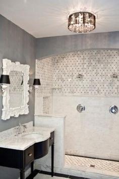 OUR BATHROOM INSPIRATION ROOM FROM THE TILE SHOP PLANO. HAMPTON CARARRA MARBLE. INSPIRATION LIGHT FROM LIGHTS PLUS $299.00. FOUND SIMILAR LIGHT @ OVERSTOCK.COM FOR $103.00.