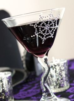 Ingredients: 1 jigger Chambord or raspberry liqueur 1 jigger Blue Curacau 1/4 cup carbonated grape soda Directions: Combine all ingredients together and pour over ice.   The glasses?  Your local craft store has jewel transfers you can use to adorn you glassware.  BLING!