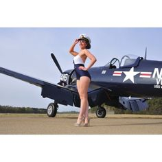 1940s style Navy pin-up girl posing with a vintage Corsair aircraft Canvas Art - Christian KiefferStocktrek Images (18 x 12)