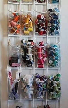 """Organize thread by color AND create more space in your sewing room by hanging this """"shoe keeper"""" behind the door! What a great idea! Sew why didn't I think of that? #accuquilt #quilting"""