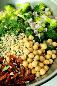 Quick and easy high protein vegan salad made with quinoa, broccoli, chickpeas, sunflowers seeds, sun-dried tomatoes and fresh dill and parley. This healthy recipe will fill you up and keep you energized. Great for lunch dinner or as a side dish. Vegetarian, dairy free, gluten free and so tasty! #veganprogram #veganrecipe #vegansalad