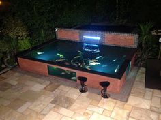 Large koi pond with pond window frame and glass
