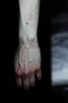 This is one of the most natural images I have seen on pinterest, and it is only a hand. The lines created from the blood rushing down into the veins stand drastically out on the background of the pale skin. The pure reality of this image is shown through the rough texture of the natural skin with the scars and scraps that come along with it.