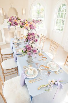 Loving this beautiful tablescape that combines touches of gold, vintage elements, and pops of color throughout, with floral arrangements at difference heights. Wedding Reception Lighting, Wedding Table, Pastel Wedding Theme, Window Box Flowers, Dinning Room Tables, Glass Votive Holders, Table Vintage, Gold Table, Decoration Table