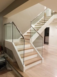 Slim base glass railing is an innovative way of attaching the glass panels to th Modern Staircase attaching base Glass innovative Panels railing Slim Modern Staircase Railing, Interior Stair Railing, Stair Railing Design, Glass Stair Railing, Railing Ideas, Stair Treads, Glass Handrail, Hand Railing, Glass Railing System