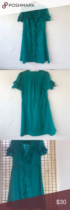 Emerald green 100% silk dress 100% silk. Green is slightly more saturated than in pictured. Flutter ruffle down middle. Knee length. Elastic waistband. Flutter detail short sleeves that can be buttoned or unbuttoned. Buttons up to collar bone level with optional tie Anthropologie Dresses