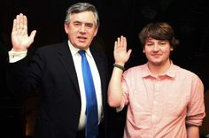 Special Envoy for Education, Gordon Brown and Plan YAG member, David, raise their hands.