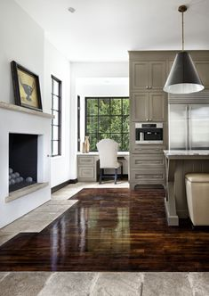 example of orange/dark floor with the light cabinets. NO!   Office/Utility cabinet color mixed with wood