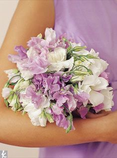 A nosegay of lavender sweet peas and white lisianthus flowers is soft and pretty.      Photo: Wendell Webber