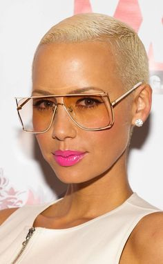 Amber Rose's. Choose glasses that complement your hair and skin tone. Blonde hair looks great with white and translucent frames. When wearing bold frames such as these, it's important to balance out the bottom part of your face with a bold lip color.Choose a frame that fits your personality. If you are outgoing and fun, pick a fun frame. If you don't like to be the center of attention, choose a frameless pair of glasses or one that blends into your face.