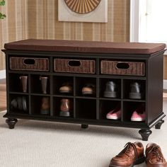 This beautiful, black shoe bench has twelve shoe storage shelves and will accommodate six to twelve pairs of shoes. The bench has a padded seat in warm espresso cover that is removable and washable. T