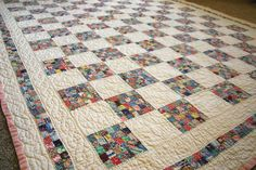 We inherited this from my husband's grandmother when she passed away. I'm trying to convince my husband it would be so much better out and in use than tucked away in a cedar chest.   This is a twin size quilt. The tiny squares are all, well, postage stamp size. Each block contains 30 squares. Hand quilting. It takes my breath away.   I've been saving scraps in the hopes of someday finding time to do a modern take on this.
