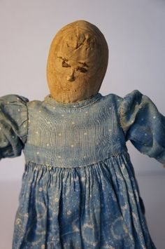A fine very early rag doll embroidered face layers of clothes