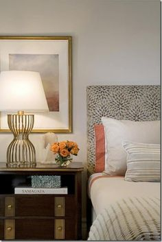 The color scheme is absolutely stunning! Soft gray and white with a pinch of coral. I love the patterned headboard and the lamp stand. Massuco Warner Miller