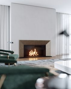 With a bespoke bold bronze surround and ribbed steel backdrop, this sophisticated and bold wall fireplace calls attention towards the focal point of this lounge space. Wall Fireplaces, Home Fireplace, Fireplace Design, Modern Fireplaces, Modern Luxury, Modern Contemporary, Modern Design, Wall Design, Living Room