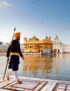 The Golden Temple rises like a shining gem over a pool in Amritsar.