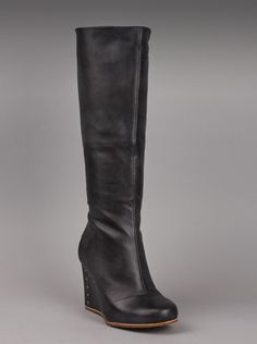 UGG® Australia Kendrick Womens Boots in Black.  Make a stunning style statement with these incredible tall black UGG® boots. These boots look so good, you'll be sad when winter ends and you aren't wearing them all the time! The stacked wedge will have you walking tall and feeling fine, no matter where you are - work, play, or time with that special someone. Truly unique womens boots.