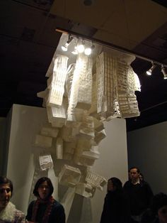 paper building from the ceiling shows how perspective can change on what the subject is depending on its orientation.