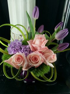 spring purple tulips  and carnations! pink roses and green lily grass with trick dianthus/  central florida wedding flowers/ www.callaraesfloralevents.com