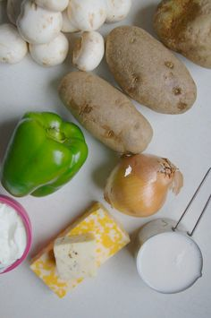 Slow Cooker Cheesy Potato Soup -- full of all these veggies, too! // neverhomemaker