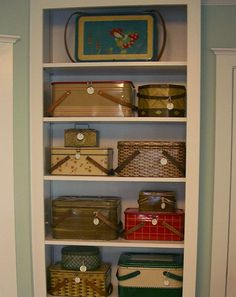 imagine...a pantry filled with vintage picnic baskets and a long list of places 'to picnic' hanging with them.