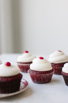 The perfect red velvet cupcakes. They are moist and flavorful, and topped with the most delicious cream cheese frosting!!
